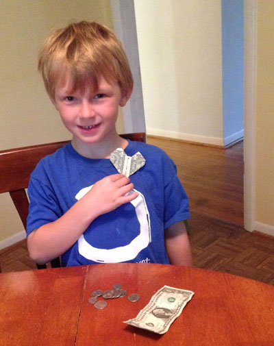 "This is Kai. His mother wrote: ""When Kai heard that a friend who is 11 years old is running 108 miles to raise money for a special project, he emptied his bank to donate to the cause - including the heart-shaped dollar that he got from the tooth fairy."""