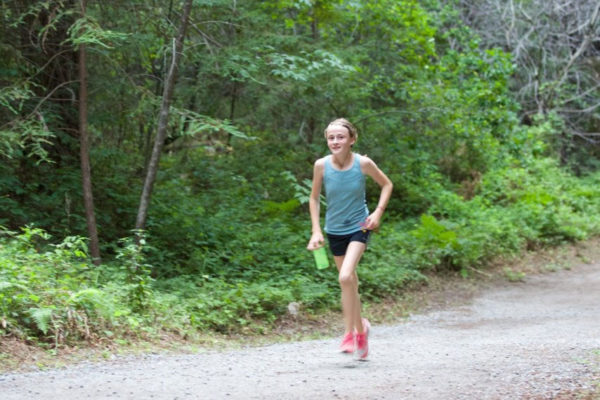 Mia Stafford runs laps around the Eight Verse Loop Trail to raise funds for the Stupa Project. Photo by Jake Nabutovsky. July 6, 2015.