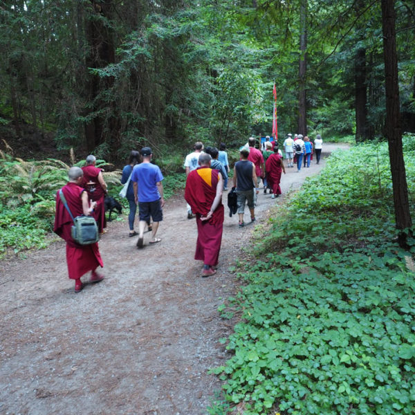 Group goes on pilgrimage around the loop trail, stopping at each of the Eight Verses of Thought Transformation. Photo by Mer Stafford. July 6, 2015.