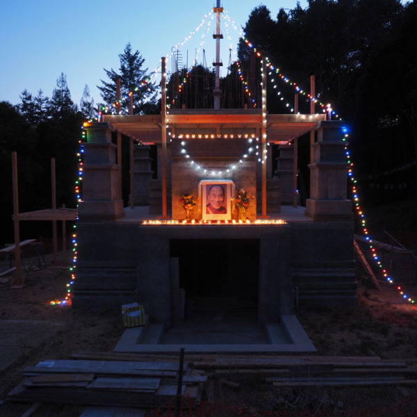 Light offerings at the stupa for His Holines the Dalai Lama's birthday. You can see that scaffolding has been put up to reach the higher levels. The 5th level is under construction. Photo by Mer Stafford. July 6, 2015.
